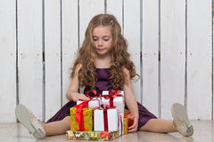 Happy little girl with gift boxes Royalty Free Stock Photo