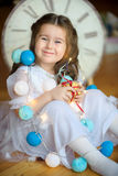 Happy little girl with a gift in hands. stock photography