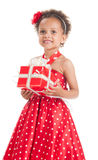 Happy little girl with a gift in mulatta hands Royalty Free Stock Photos