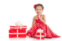 Happy little girl with a gift in mulatta hands Royalty Free Stock Image