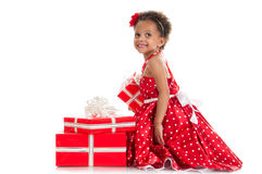 Happy little girl with a gift in mulatta hands Royalty Free Stock Photo
