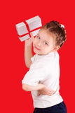 Happy little girl with a gift for Valentine's Day Royalty Free Stock Image