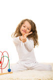 Happy little girl gives thumbs Royalty Free Stock Images