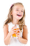 Happy little girl with glass of juice isolated Royalty Free Stock Images
