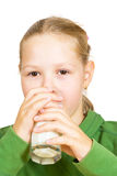 Happy little girl with a glass of milk Royalty Free Stock Photos