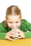 Happy little girl with a glass of milk Stock Photography