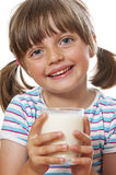 Happy little girl with glass of milk Stock Image