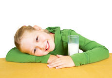Happy little girl with a glass of milk, isolated Stock Photo