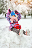 Happy little girl goes down on sleds stock photo