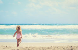 Happy little girl going to swim at beach Royalty Free Stock Images
