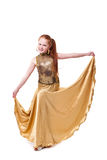 Happy little girl in gold dress Royalty Free Stock Photography