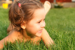Happy little girl in the grass. Portrait of a happy little girl in the grass stock photography