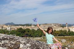 Little girl with Greek flag Corfu town Greece Royalty Free Stock Image