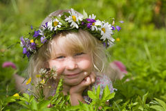 Happy little girl on green meadow Royalty Free Stock Images