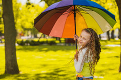 Happy little girl in the green park Royalty Free Stock Photo