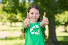 Happy little girl in green with thumbs up Stock Photography