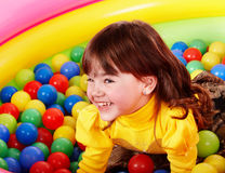 Happy little girl in group l ball. Stock Photography