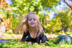 Happy little girl in halloween costume with jack Royalty Free Stock Images