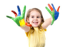 Happy little girl with hands painted in color Stock Photo