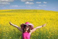 Little girl with hands up on field spring season Royalty Free Stock Photography