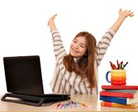 Little girl with hands up and laptop at home Stock Images