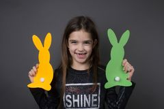 So happy little girl. With two paper easter decoration bunnies Stock Images