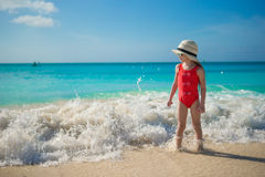 Happy little girl in hat at beach during caribbean vacation Royalty Free Stock Photos
