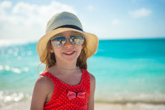 Happy little girl in hat on beach during summer Stock Photography