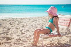 Happy little girl in hat on beach during summer Stock Photo
