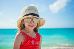Happy little girl in hat on beach during summer Royalty Free Stock Images