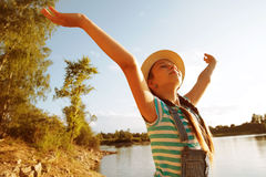 Happy little girl in a hat with open arms Royalty Free Stock Photo