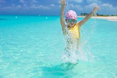 Happy little girl have fun at beach during Royalty Free Stock Images
