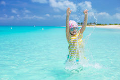 Happy little girl have fun at beach during summer Stock Photo