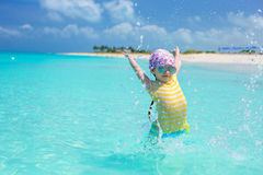 Happy little girl have fun at beach during summer Stock Photography