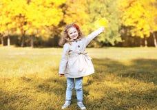 Happy little girl having fun in autumn park Royalty Free Stock Photo