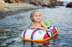 Happy little girl  having fun bathing in sea Royalty Free Stock Photos