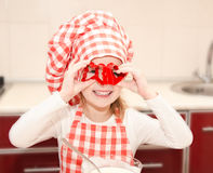Happy little girl having fun with form for cookies in chef hat. On kitchen Royalty Free Stock Photos