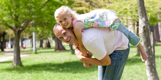 Happy little girl having fun with her father Royalty Free Stock Images