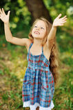 Happy little girl having fun outdoors Stock Photography