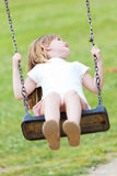 Happy little girl having fun in the park. Royalty Free Stock Images