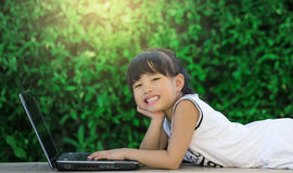 Happy little girl having fun play laptop Royalty Free Stock Photography