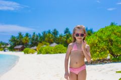 Happy little girl having fun at shallow water Stock Photos