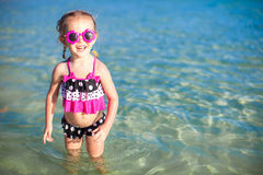 Happy little girl having fun at shallow water Royalty Free Stock Photo