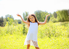 Happy little girl having fun. In summer day Stock Photo