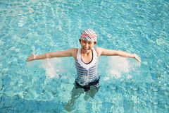 Happy little girl having fun  in swimming pool Royalty Free Stock Photo