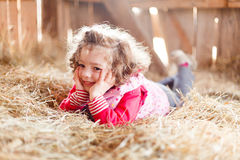 Happy Little Girl in Hay Royalty Free Stock Photos