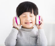 Happy little Girl with Headphones Listen Music Royalty Free Stock Photography