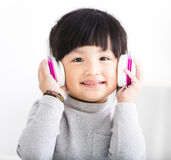 Happy little Girl with Headphones Listen Music Royalty Free Stock Photos