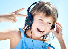 Happy little girl in headphones Royalty Free Stock Photos