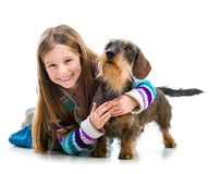 Happy little girl with her dachshund Stock Photo
